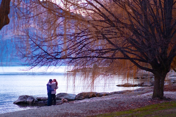 """What do you get when you kiss a guy? You'll get enough germs to catch Pneumonia."" Candid shot of a couple kissing under a tree during sunset in Queenstown."